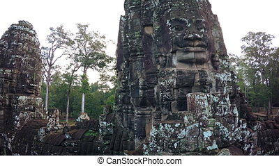 Stone towers with faces in Bayon temple, Cambodia.