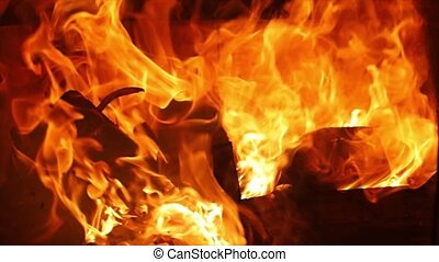 Flames of a fireplace - Burning fire in a home fireplace,...