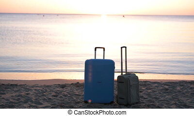 Two suitcases on the beach - Travel suitcase is alone on a...