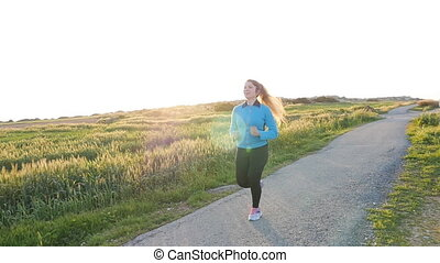 Running woman. Female Runner Jogging during Outdoor Workout...