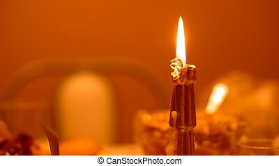 Burning candle on a table close-up New Year. - Burning...