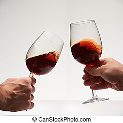 Happy cheers with two red wine glasses