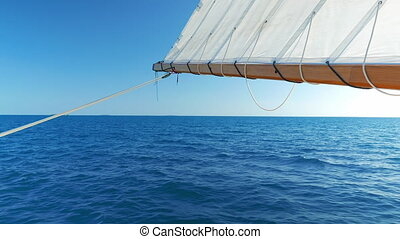 Sail Being Hold by the Back of the Boat - Sun blocked by the...