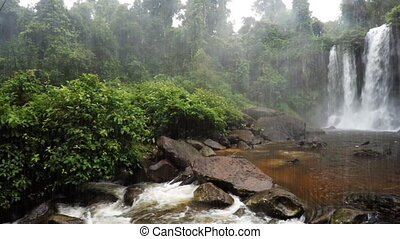 Waterfall Panorama during a tropical shower. 1080p video...