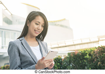 business woman using smartphone at city, bangkok, asia