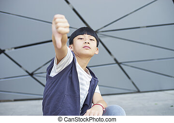 portrait of cool Asian kid posing outdoors - portrait of...
