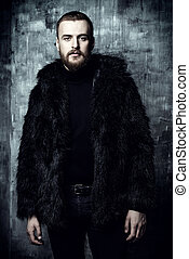 bearded man in fur coat