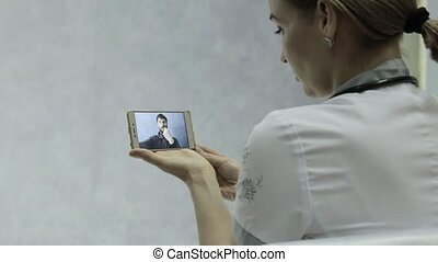 On-line medical consultations. male patient video chatting...