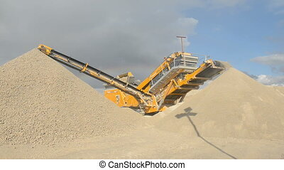 Stone crusher at the quarry - Establishing shot of machine...