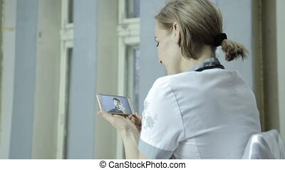 On-line medical consultations. male patient video chatting with doctor on phone