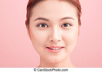 Close up beautiful young Woman face on pink.
