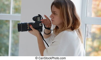 Photographer work with model in studio. Backstage. - Female...
