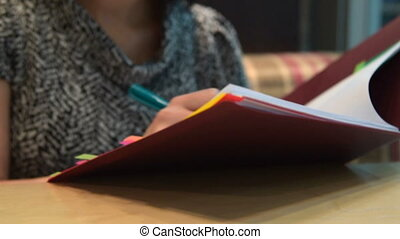 Woman working with business documents in cafe -...