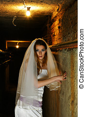 Frightened bride in dungeon - Frightened bride in white...