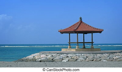 Gazebo on the beach. Bali, Indonesia. Video with panning