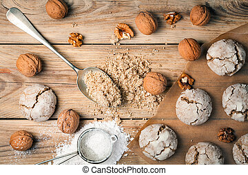 Cracked nut cookies on Wood Background