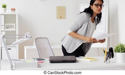 businesswoman with laptop and papers at office - business,...