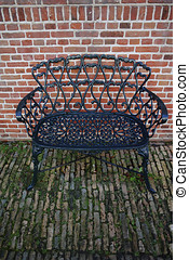 Decorative wrought iron bench in the garden