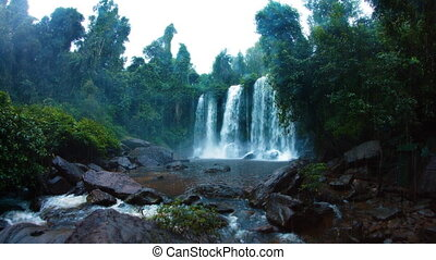 Rain and a tropical waterfall in Phnom Kulen National Park....