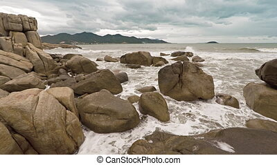 Stones on an ocean coast at Hon Chong rocks. Nha Trang,...