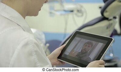 On-line medical chatting. male senior patient having video...
