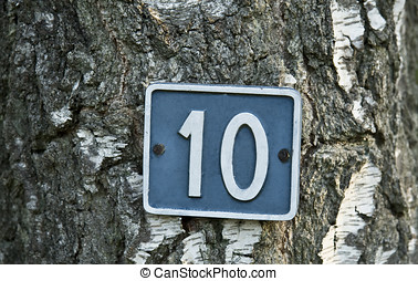 Number 10 - White number 10 on blue background attached to a...