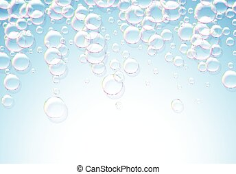 Soap bubbles abstract blue background with rainbow colored...