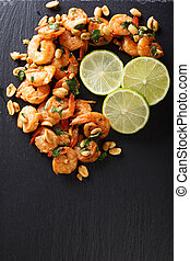 Spicy sauteed of shrimp, peanuts, lime and herbs closeup....