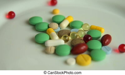 Plate with many pills, overdose - Close-up shot of pouring...