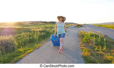Hapy young woman with suitcase. Travel concept - Hapy young...