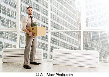 Full length of fired office worker standing in the office -...