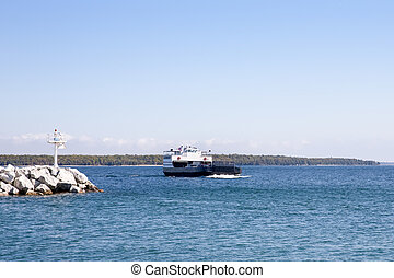 Car Ferry Entering a Harbor with Copy Space - Car ferry on...