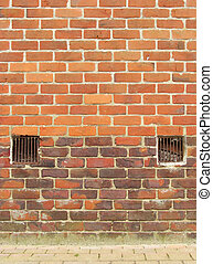 old brick wall with 2 ventilation exit