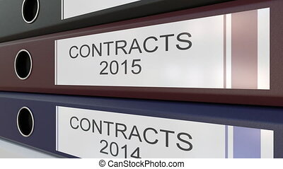 Office binders with Contracts tags different years - Line of...
