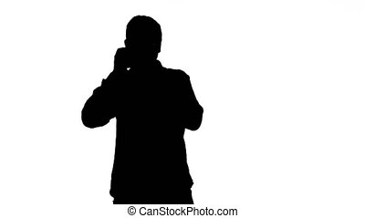 Photographer in Silhouette Taking Photos and moving Over...