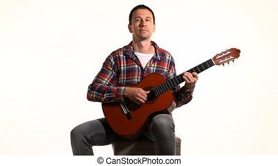 man playing classical guitar close up