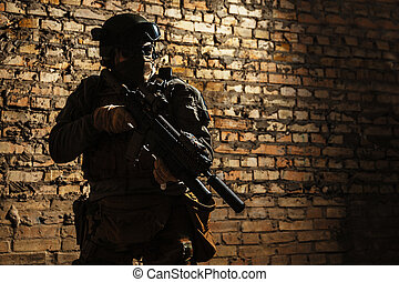 Army soldier with weapons - Special forces operator pointing...