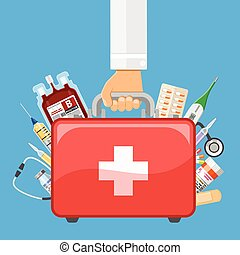 first aid kit in doctor hand - Doctor holds in hand first...