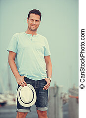 Handsome fashion man on pier in port with yachts. - Handsome...