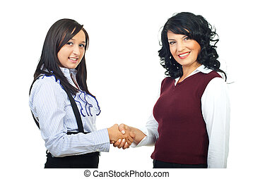 Two executives women shaking hands - Two beautiful...