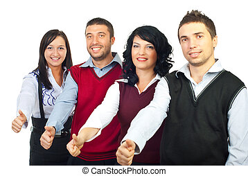 Four business people giving thumbs - Four business people...