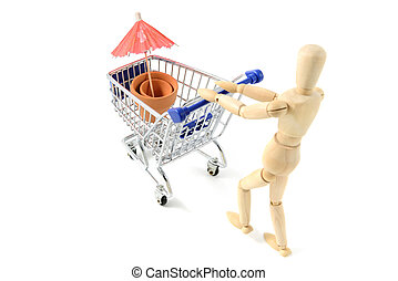 wooden mannequin shopping garden utensils in a shopping cart at white isolated background