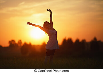 Woman on sunset background