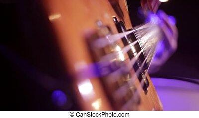 Electric guitar close-up. - Man playing electric guitar,...
