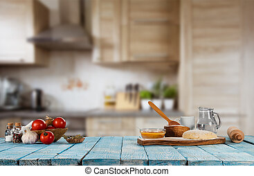 Baking ingredients placed on wooden table, ready for...