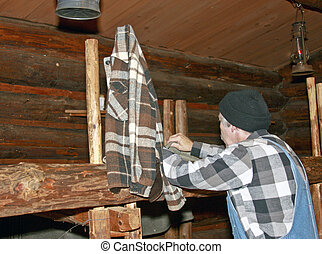 lumberjack making bed - logger prepares the bed for sleeping...