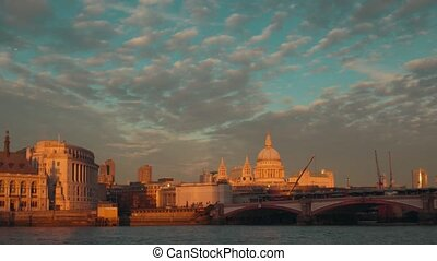 View to the City of London, Blackfriars Bridge and Saint Paul's Cathedral from Thames embankment. With clouds.