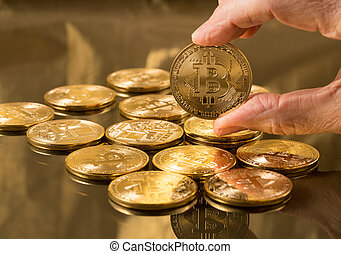 Stack of bitcoins with gold background - Stack of bit coins...