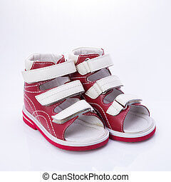 children's orthopedic shoes on a white background