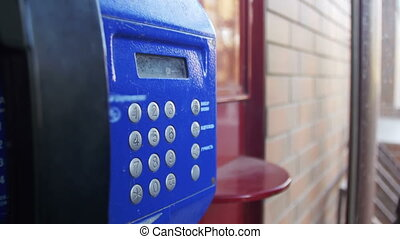 Old, Vintage Blue Telephone with Number Buttons in the Phone...